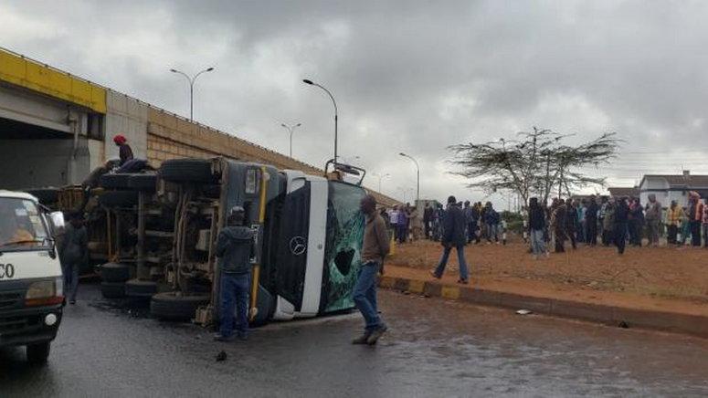 An overturned truck along a highway in Kenya.