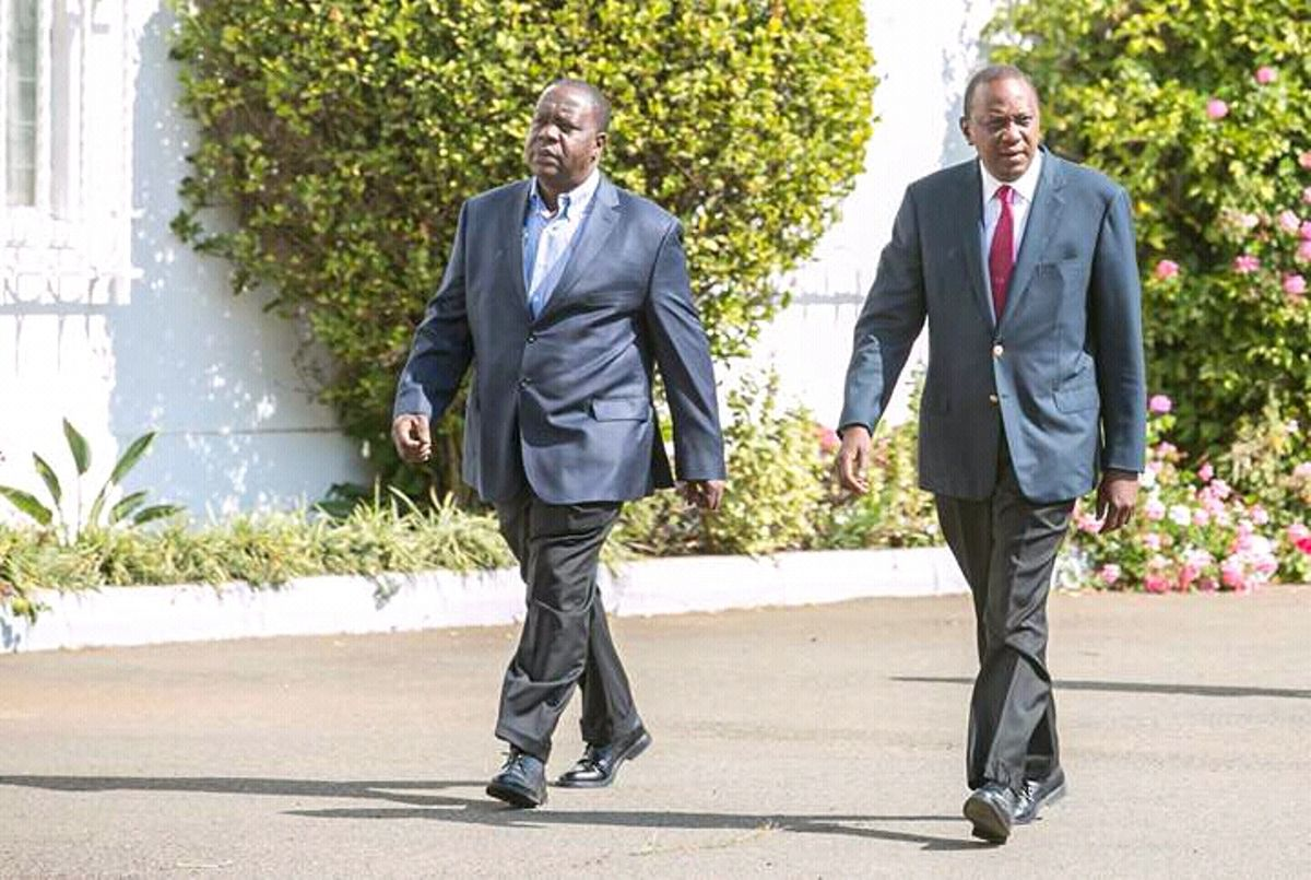 President Uhuru Kenyatta (Right) strolls at State House with Interior CS Fred Matiang'i during a past event.