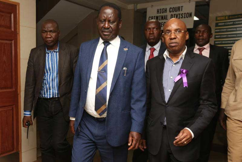 ODM leader Raila Odinga (left) and businessman Jimi Wanjigi leave the court.