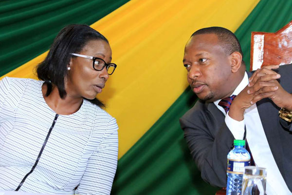 Nairobi Speaker Beatrice Elachi (left) has a word with Governor Mike Sonko (right) during the swearing-in of CECMs at Charter Hall on November 10, 2017.
