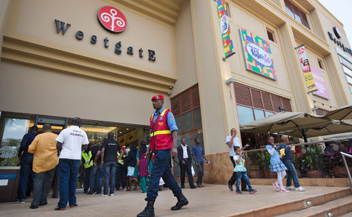 People going about their day to day activities outside the Westgate Mall.
