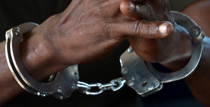 Hands of man in handcuffs