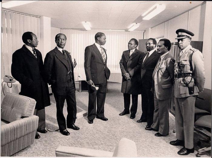 Former President Daniel Moi (third left) addresses a team that included GG Kariuki (second right).