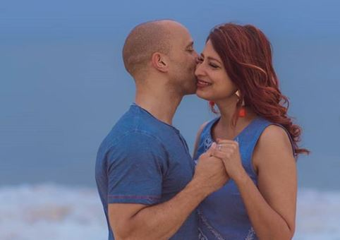 Eve D'souza and her fiance Simon Anderson when she got engaged in a beach in India.