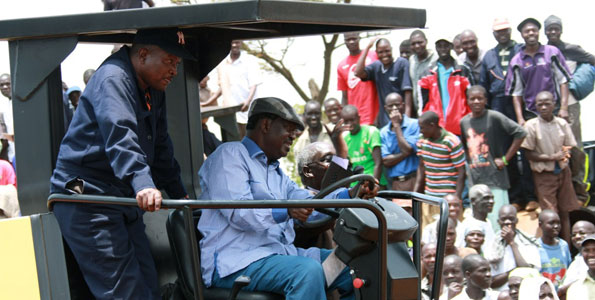 Former Prime Minister Raila Odinga operating a tractor during the launch of
