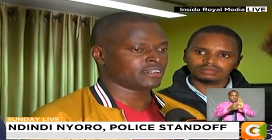 Kiharu MP Ndindi Nyoro and a colleague at Citizen TV offices where he was evading police arrest.