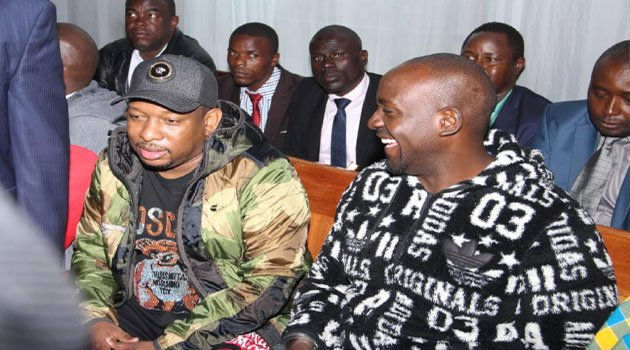 Nairobi Governor Mike Sonko (in cap) arraigned at Milimani Court in Nairobi on Monday, December 9, 2019.