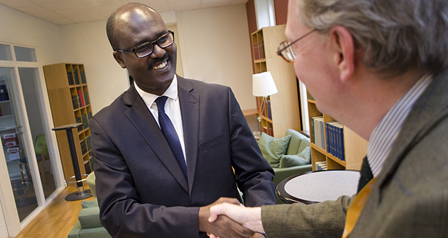 Mr. Gilbert Sebihogo, NANHRI's Executive Director, shaking hands with Rolf Ring, RWI's Deputy Director,