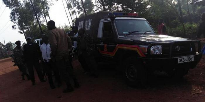 Image of Kenya police car at a crime scene. A woman and her daughter's bodies were found with stab wounds inside her house in Thika on Sunday, December 15, 2019.