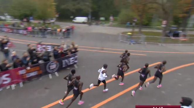 Eliud Kipchoge (in white) running in Vienna, Austria in the INEOS 1:59 challenge. He ran in between pacemakers