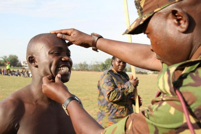 A candidate being checked by a KDF officer during recruitment in 2018. Photo: Daily Nation.