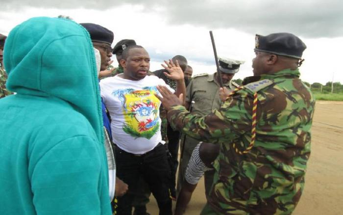 Nairobi Governor Mike Sonko in an altercation with police officers during his arrest in Voi, on December 6, 2019.