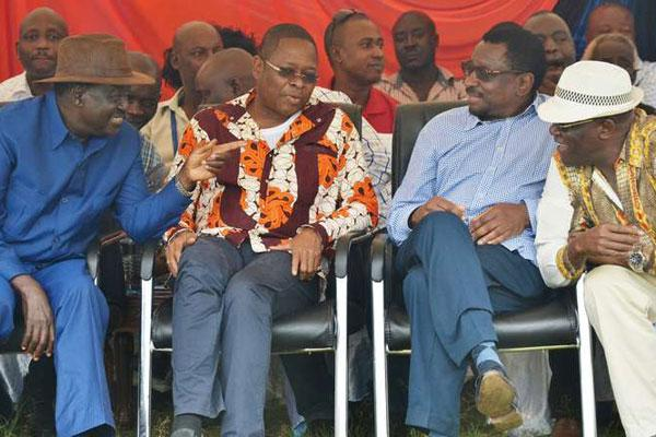 Cord leader Raila Odinga (left), Siaya Senator James Orengo and former Machakos Senator Johnson Muthama (right) chat during the burial of Nominated MCA Grace Chihanga in Kilifi County in June 2016