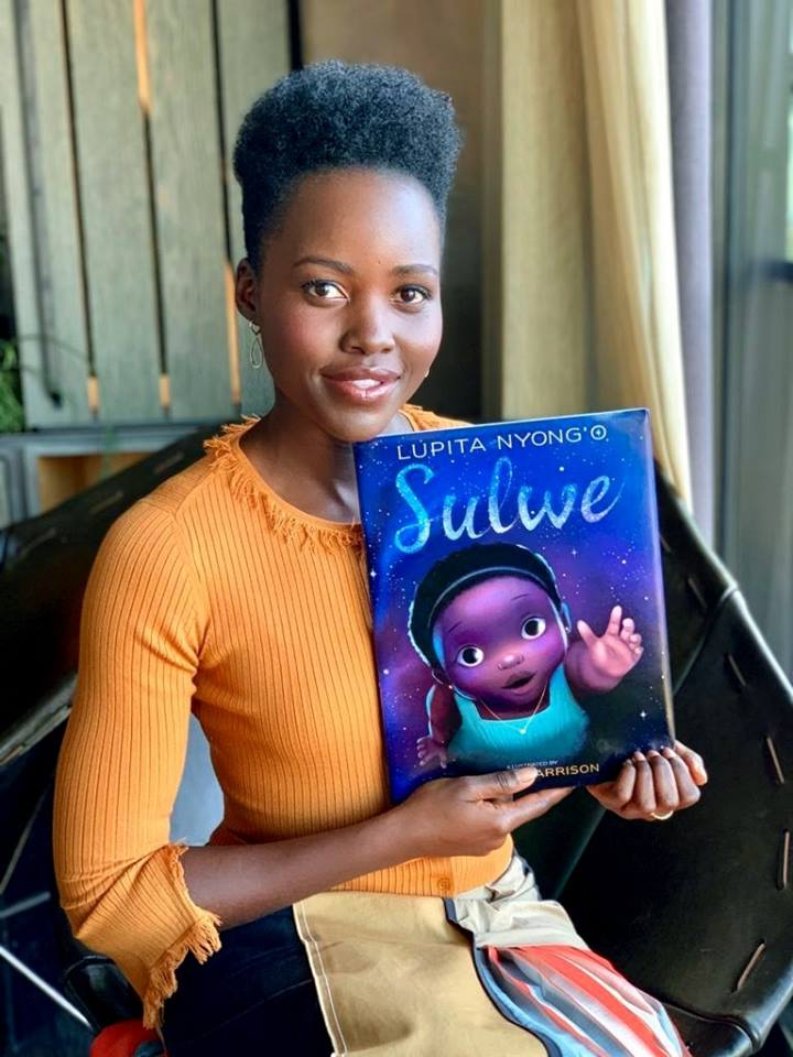 Lupita Nyong'o holding her new book 'Sulwe'.