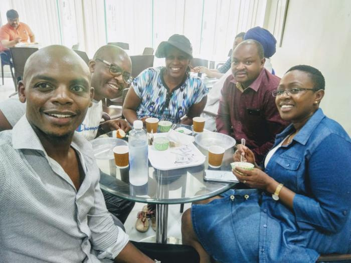 Singer Jimmy Gait takes a selfie with MP Sabina Chege and other friends in India.