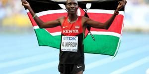 Asbel Kiprop poses with the Kenyan flag after winning the 1500m at the 2013 World Athletics Championships in Moscow, Russia