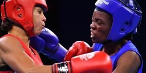 Northern Ireland's Carly McNaul (L) and Kenya's Christine Ongare fight