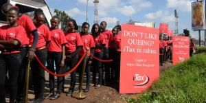 A photo of models at a mock queue along Mombasa Road, Nairobi during the launch of a countrywide campaign by the Kenya Revenue Authority (KRA) to sensitise all taxpayers to adopt the online platform iTax to file returns in 2015.