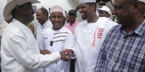 ODM leader Raila Odinga (left) greets leaders of the North Eastern region  during his arrival in Garissa on February 23, 2020, for a BBI rally.