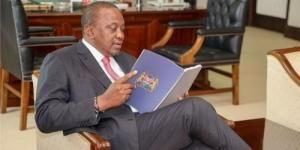 President Uhuru Kenyatta goes through the BBI report after receiving it at State House in November 2019