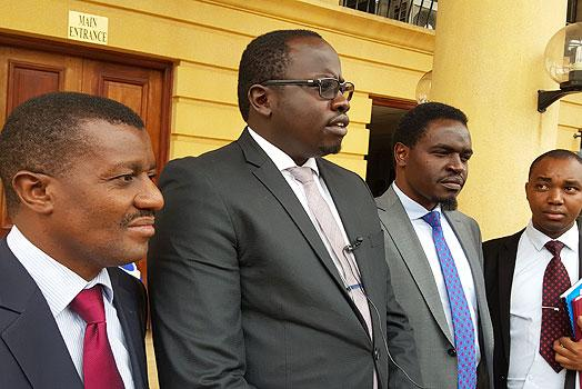 Lawyers Daniel Maanzo, Ham Langat (centre) and Nelson Havi address journalists at the Miliamani law courts on January 10, 2018.