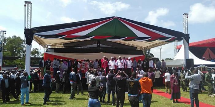 Leaders on stage at the William Ole Ntimama Stadium in Narok during a Building Bridges Initiative (BBI) meeting on Saturday, February 22