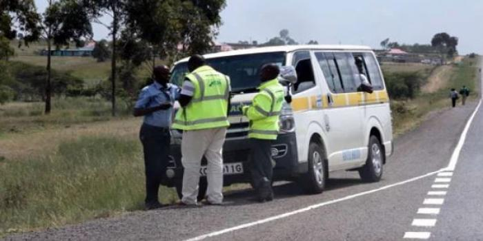 NTSA officials pictured inspecting a matatu on the Nairobi-Nakuru Highway in December 2019