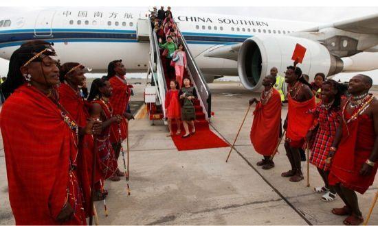 Traditional Kenyan Masaai dancers welcome Chinese tourists disembarking from a China Southern Airlines plane at Jomo Kenyatta International Airport in Nairobi, Kenya on Aug 5, 2015