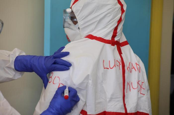 A medical practitioner has her name written on the protective gear at a Coronavirus isolation and treatment facility in Mbagathi District Hospital on Friday, March 6, 2020.