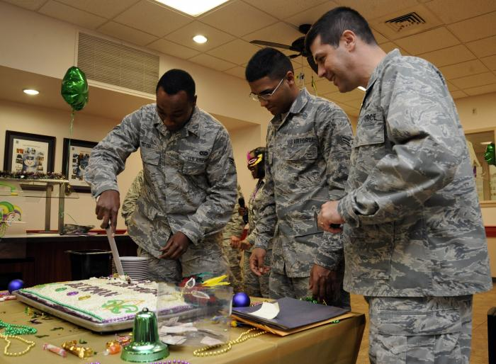 Airman 1st Class Kevin Yator (L) cuts a birthday cake during the Airmen Birthday Meal at the Barksdale Air Force Base in Los Angeles California.