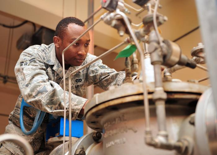 Air Force Airman 1st Class Kevin Yator troubleshoots an automatic valve for an aircraft fueling system in Southwest Asia, Jan. 24, 2014.