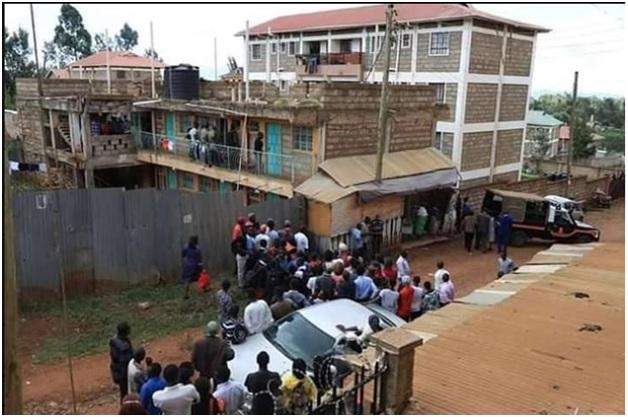 Members of the public at the scene of crime where a Chuka university committed suicide after killing lover in April 2018