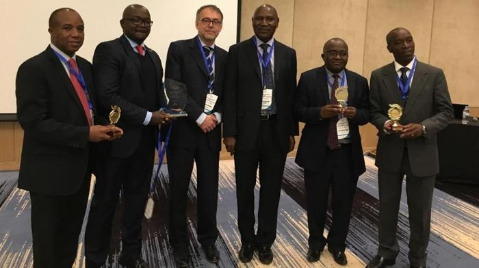 Former Auditor General Edward Ouko(third right) along with members of the office of the auditor general in Kigali 2017 when they were awarded a Best Performance Aurdit Report Award. The office is under investigation following irregularities in the purchase of a vault software system.