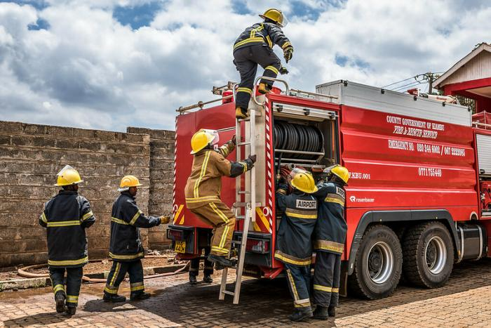 Kiambu Fire Fighters during a past training session. They used hanging ropes to rescue a man trapped midstream a flooded river.