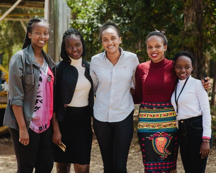 First daughter Ngina Kenyatta (centre) with beneficiaries of The Kenyatta Trust, during   the prize-giving ceremony for Form 3 & 4 high school students, at the 2019 Janjaruka Leadership Camp.