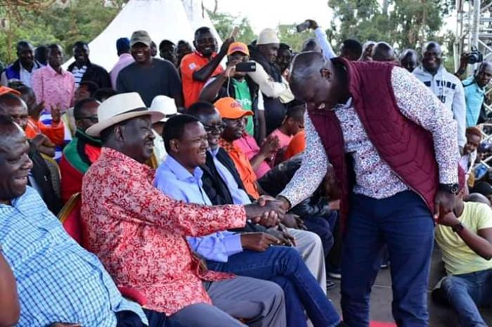 Cherangany MP Joshua Kutuny shakes hand with ODM leader Raila Odinga