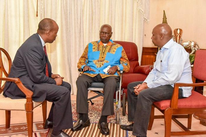 Former President Moi(center) and son Gideon Moi(right) at their Kabarak home. In 2002, Moi's sons accused Joshua Kulei of allegedly withholding property from their father.