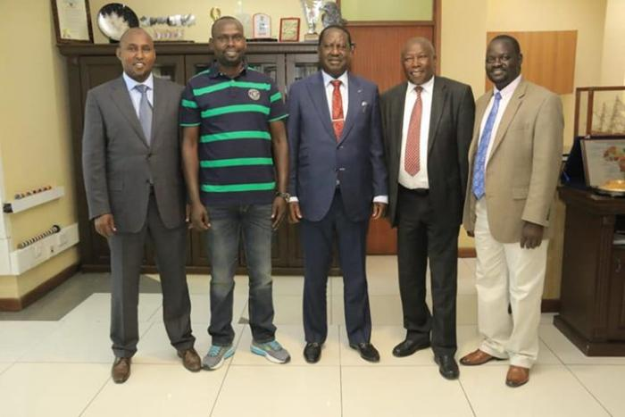 Raila Odinga with Imran Okoth, Junet Mohamed and Maina Kamanda who declared his support for Imran in Kibra race