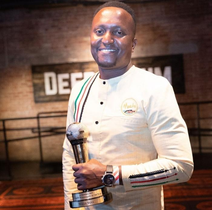 Mambo Mseto host poses with an award for Best Radio/TV Presenter in Africa at the AFRIMMA awards in October 2019