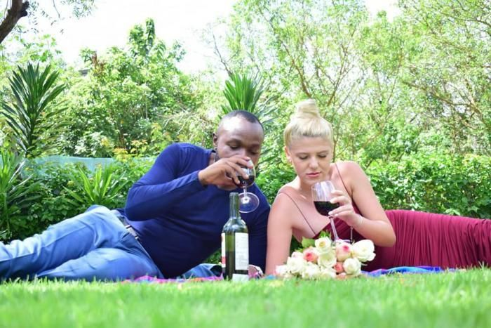 KTN journalist Tobias Chanji shares a glass of wine with his lover during their getaway on Sunday, January 5, 2020.
