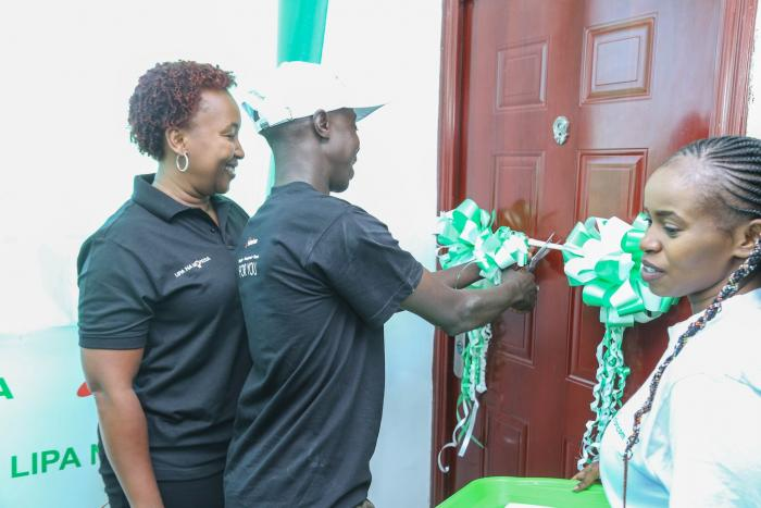 Joseph Kipkurui cutting the ribbon to his new three bedroom apartment