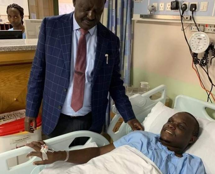 A photo of Raila visiting ailing Norman Magaya. Dikembe accused ODM leaders of disobeying Raila's orders for the ex-NASA boss's health to be given top priority status