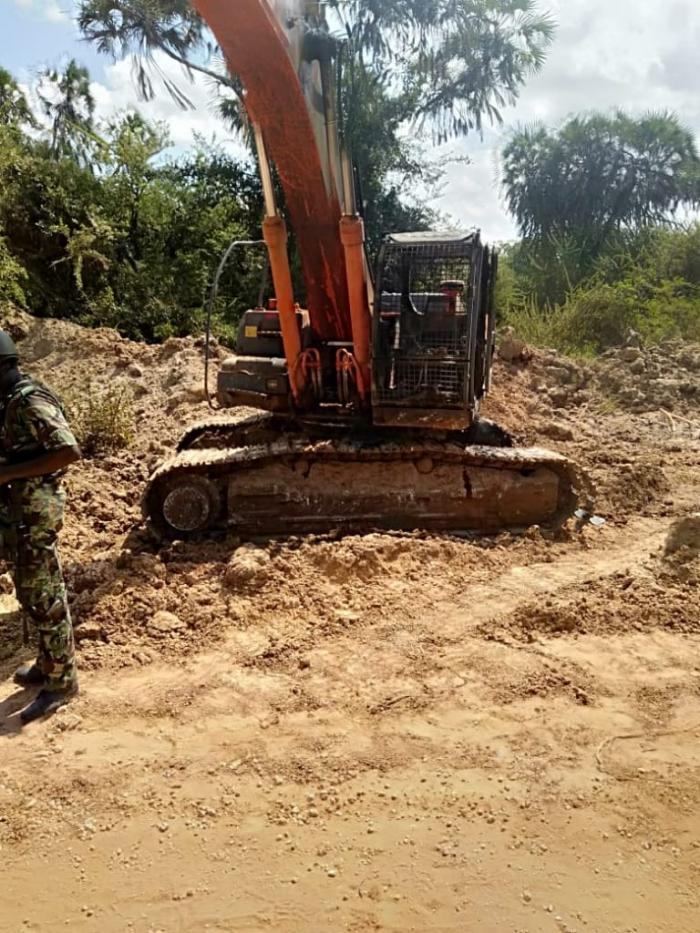 A stalled excavator that was set ablaze by suspected Al Shabab Militia on February 9.