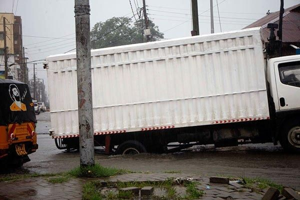 A truck transporting goods from Majengo is stuck after the road caved in following heavy downpour in Mombasa and its environs on November 12, 2019.