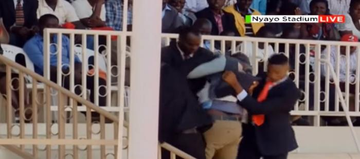 The 30-year-old Daniel Wekesa being thrown out of Mzee Moi's funeral service on Tuesday, February 11