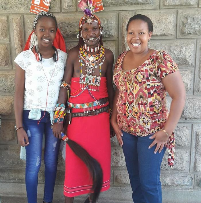 Abby Ruto (l) and her mum Prisca Bett (r) pose with a Masaai.