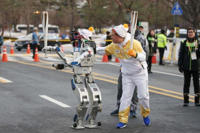 The robot carrying the Olympic torch in 2018 was designed by AI Brain where Odoyo is a Director