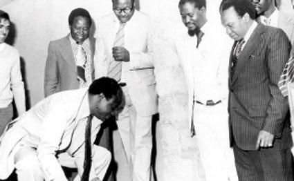 Vice President Mwai Kibaki lays a foundation stone at the Kenya Bureau of Standards in 1978. Looking on is KEBS' Deputy Director Raila Odinga