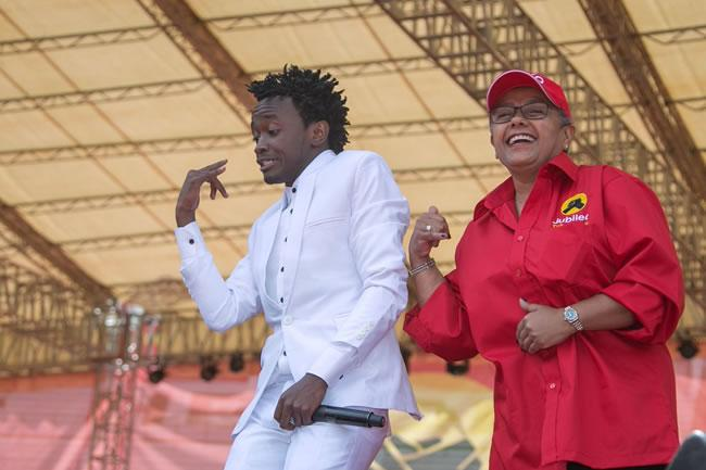 Bahati performing alongside First Lady Margaret Kenyatta during the launch of Jubilee Party at Kasarani Stadium on September 10, 2016