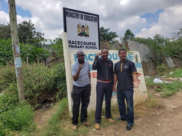 Boniface Mwangi and Haki Africa's Executive Director, Hussein Khalid at Racecourse Primary School in Nairobi. November 20, 2019.